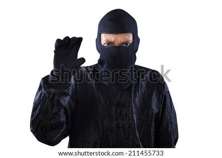Portrait of dangerous bandit taking something on copyspace, isolated on white background - stock photo