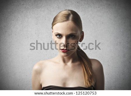Portrait of dark blonde model with blue eyes - stock photo