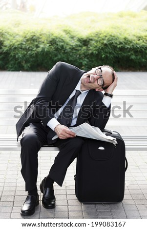 Portrait of Desperate businessman with newspaper in his hands  - stock photo