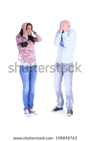 Portrait of desperate couple isolated over white background - stock photo