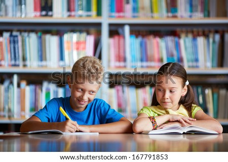 Portrait of diligent schoolchildren sitting at lesson - stock photo