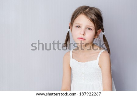 Portrait of disaffected preschooler girl at home - stock photo