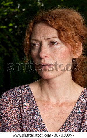 portrait of disappointed young woman - stock photo