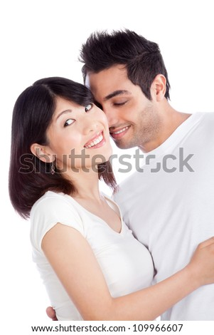 Portrait of diverse young couple isolated on white background. - stock photo