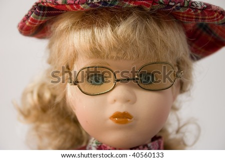 portrait of doll face with glasses - stock photo