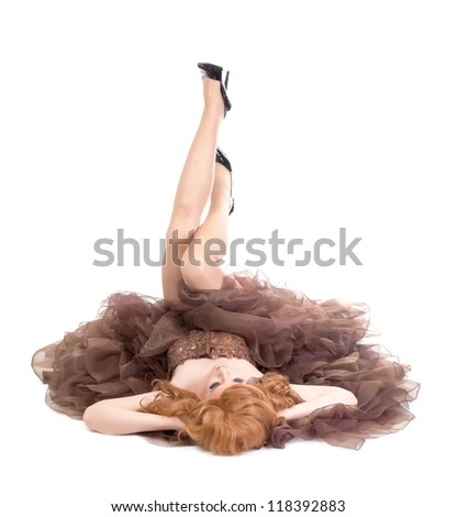 Portrait of drag queen lying on floor. Man dressed as Woman, isolated on white background - stock photo