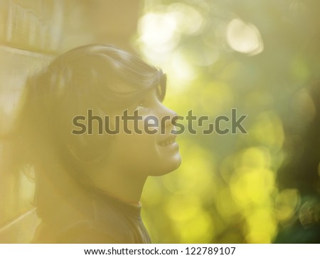 Portrait of dreaming little boy in nature - stock photo