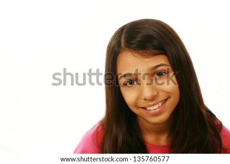 portrait of East Indian girl smiling on white background - stock photo