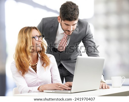 Portrait of efficiency sales team working on laptop, while sitting at office. Business team. - stock photo