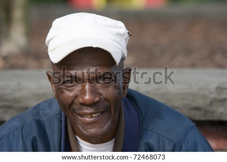 Portrait of elderly African American man outside in the daytime. - stock photo