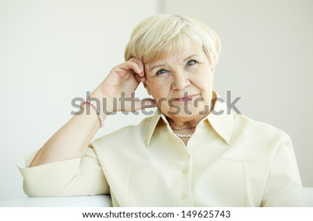 Portrait of elderly female looking at camera - stock photo