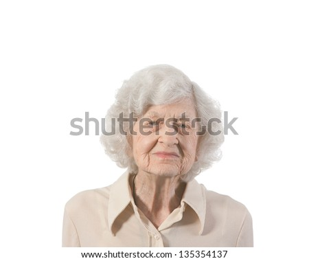 Portrait of elderly lady. Shot against white background with copy space provided. - stock photo