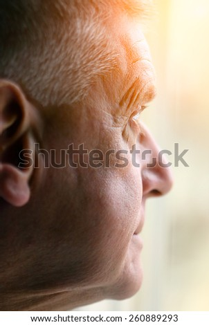 Portrait of Elderly man lost in thought - stock photo