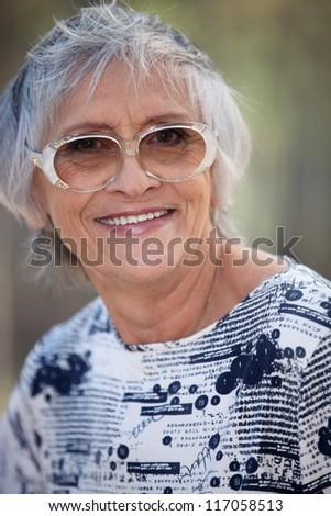 Portrait of elderly person - stock photo