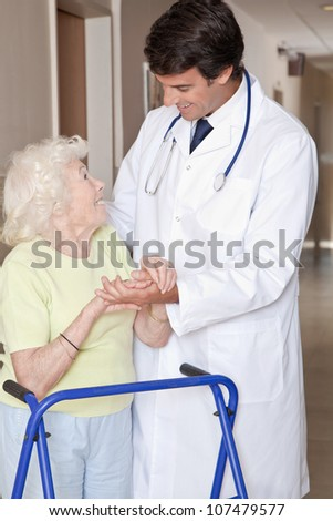 Portrait of elderly woman and doctor with zimmerframe. - stock photo