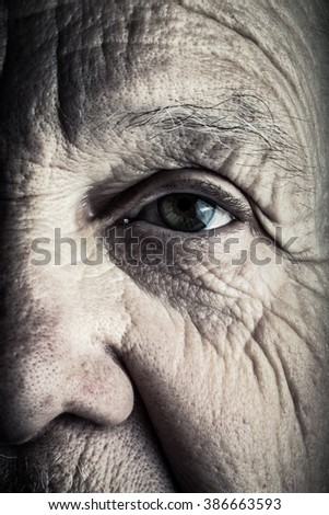 Portrait of elderly woman. Closeup view. Toned. - stock photo