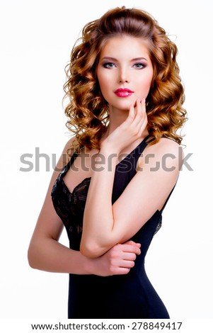 Portrait of elegant beautiful woman in black dress with hand near face - isolated on a white background. - stock photo