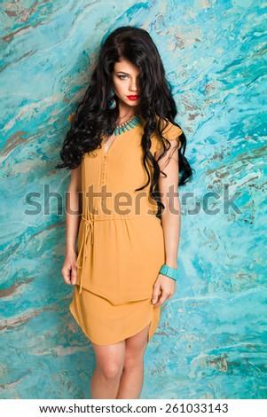 Portrait of elegant beautiful woman in yellow dress - stock photo