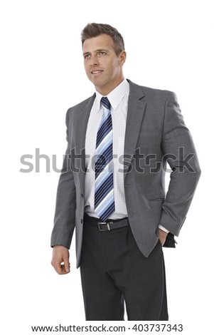 Portrait of elegant businessman looking away, hand in pocket. - stock photo
