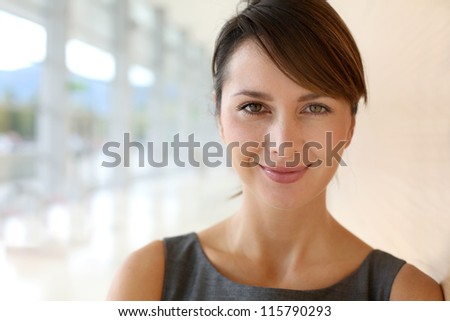 Portrait of elegant businesswoman standing in hallway - stock photo