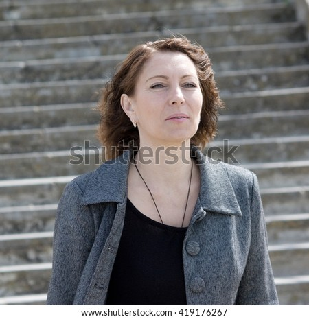 Portrait of elegant middle aged woman - stock photo