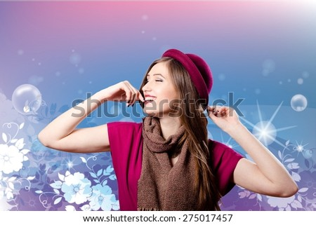 Portrait of elegant smiling pretty woman in red hat enjoying on floral background - stock photo