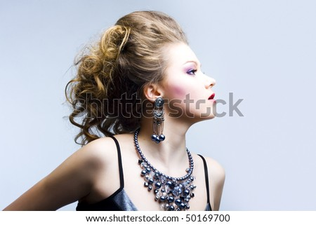 Portrait of elegant young blond girl. Profile view - stock photo