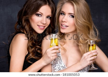 Portrait of elegant young women with a champagne glasses at celebration - stock photo