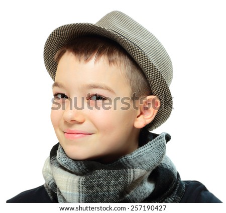Portrait of eleven years boy clothing a hat on white background  - stock photo