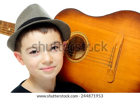 Portrait of eleven years old boy with guitar on white background  - stock photo