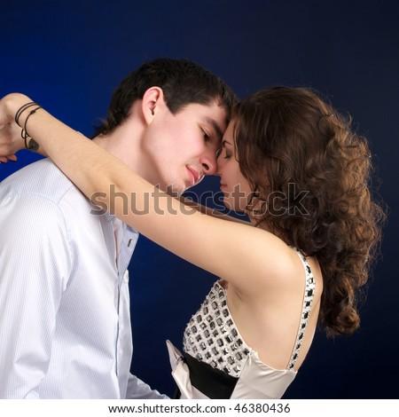 Portrait of embracing beautiful sexual couple - stock photo