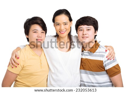 Portrait of Embracing Korean family of three - stock photo