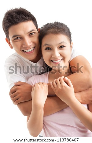 Portrait of embracing lovers isolated on white - stock photo