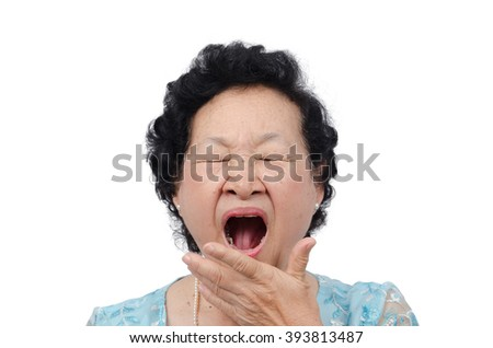 Portrait of emotion asian senior woman with yawn expression on white background, with clipping path - stock photo
