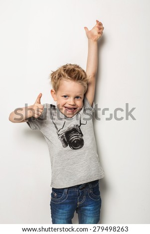 Portrait of emotionally kid. Studio portrait over white background - stock photo