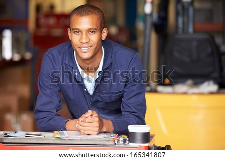 Portrait Of Engineer Standing In Factory - stock photo