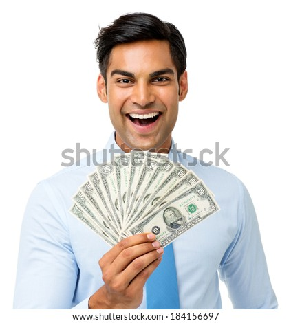 Portrait of excited businessman holding fanned out fifty dollar notes against white background. Horizontal shot. - stock photo