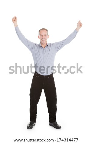 Portrait Of Excited Businessman Raising Hand Over White Background - stock photo