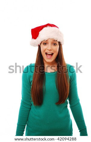 Portrait of excited girl in santa hat on white - stock photo
