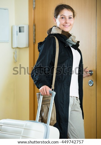 Portrait of excited girl  leaving home for vacation - stock photo