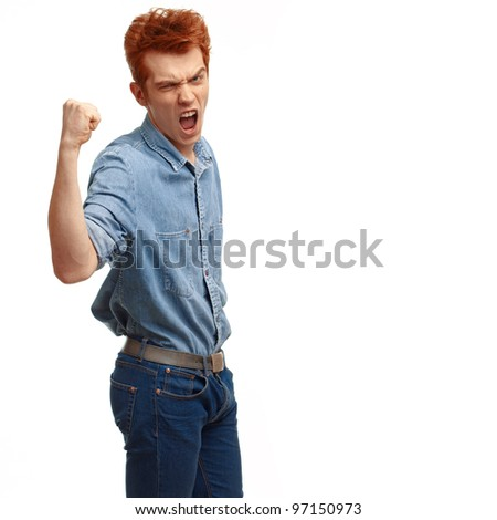 Portrait of excited red haired young man cheering success with clenched fist, isolated on white background. - stock photo