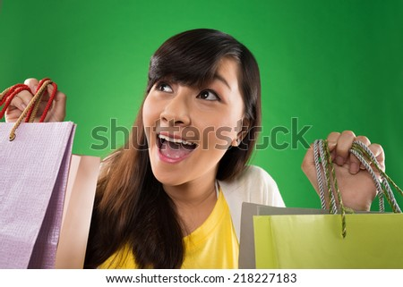 Portrait of excited shopaholic with paper bags - stock photo