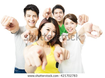 Portrait of excited young student people pointing at you - stock photo