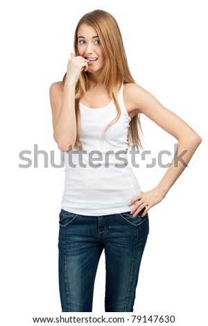 Portrait of excited young woman biting her nails. Isolated on white background - stock photo