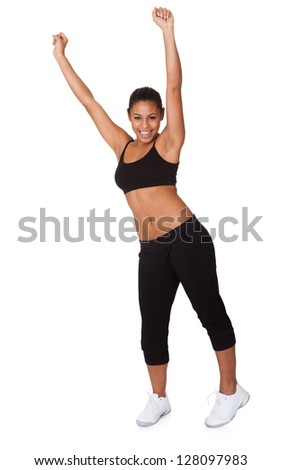 Portrait Of Excited Young Woman Jumping. Isolated On White - stock photo