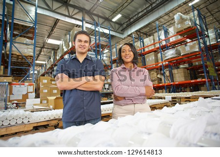 Portrait Of Factory Worker And Manager On Production Line - stock photo