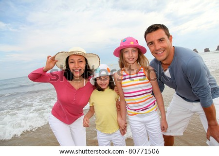 Portrait of family at the beach - stock photo