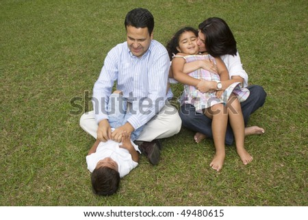 Portrait of family, mom and dad walking with their children at home - stock photo