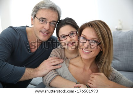 Portrait of family of 3 people wearing eyeglasses - stock photo