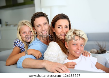 Portrait of family relaxing in sofa - stock photo